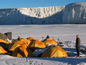 Though we weren't able to camp at this site, the yellow tents were a welcome vision! (photo courtesy of Tusker Trails)